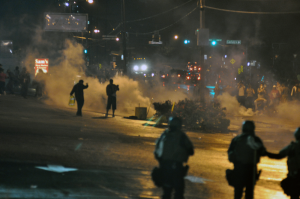 Police officers using tear gas during the first wave of the Ferguson unrest